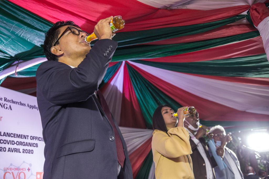 Madagascar's President Andry Rajoelina drinks a sample of the Covid Organics or CVO remedy at a launch ceremony in Antananarivo on April 20, 2020