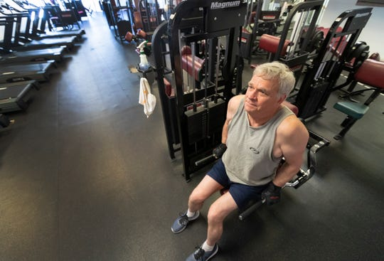 Long-time member Dave Riebe finishes his workout at Real Health & Fitness Center in downtown Cedarburg. Owner Bob Hahn reopened the doors on Monday.
