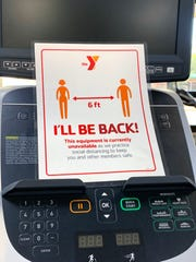 The YMCA of Greater Waukesha County staff has signs on equipment to indicate proper social distancing.