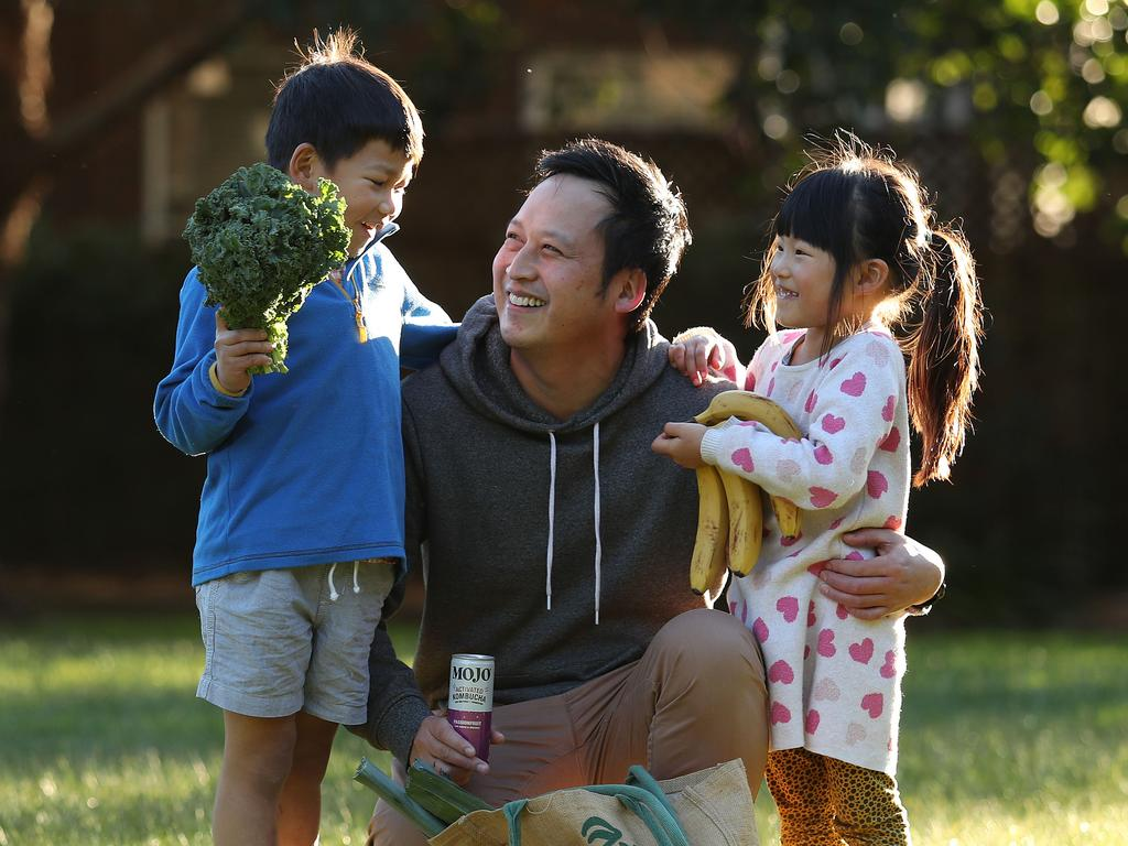 Joseph Leung with his son Jethro, 7, and daughter Cassidy, 4, in Randwick. Picture: Brett Costello