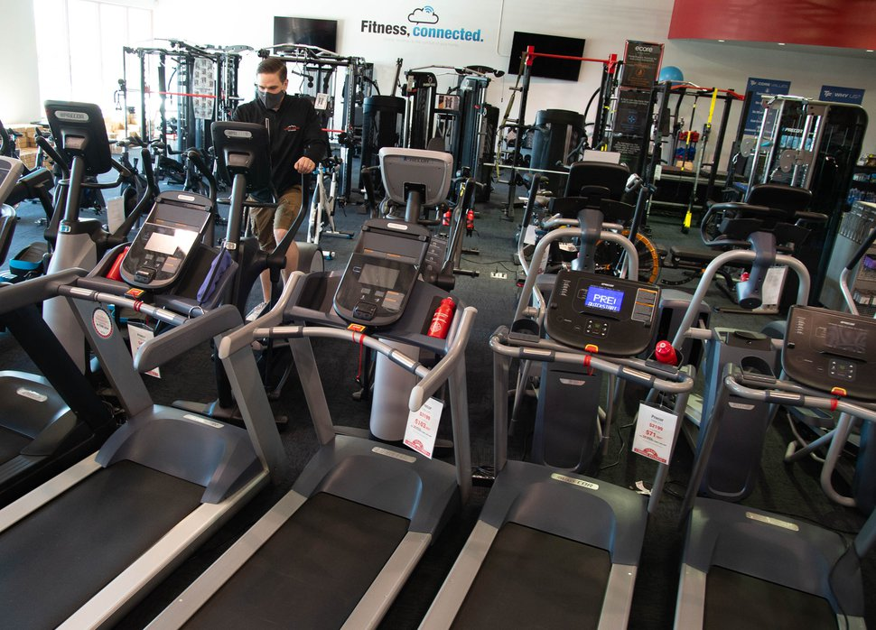 (Francisco Kjolseth | The Salt Lake Tribune) Chase Buckles, sales manager at Utah Home Fitness in Sandy, discusses popular exercise equipment on Wednesday, Oct. 22, 2020. Home fitness equipment sales boomed in March and April when gyms closed because of the coronavirus. Everything from inexpensive dumbbells to premium treadmills and ellipticals were wiped out of stores and warehouses. Record sales continued throughout the summer — normally the slow time for the industry, and store owners expect sales to remain high during the holidays.